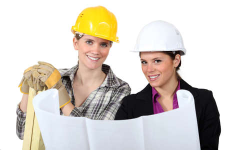 craftswoman: craftswoman and businesswoman looking at a blueprint