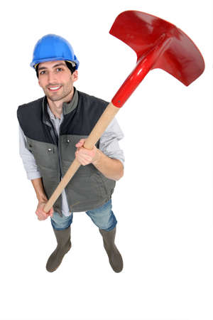 the unskilled worker: A workman holding a spade Stock Photo