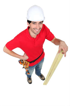 Casual carpenter stood with timber Stock Photo - 17219570