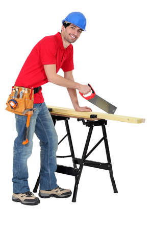 Carpenter sawing Stock Photo - 17219789