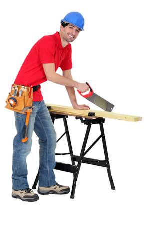 Carpenter sawing Stock Photo - 17219789