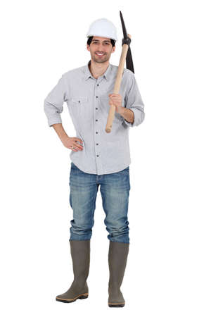 pick: Man holding pick-axe over shoulder Stock Photo