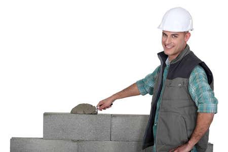 Bricklayer building a block wall photo