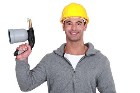 blowtorch: Man holding blowtorch Stock Photo