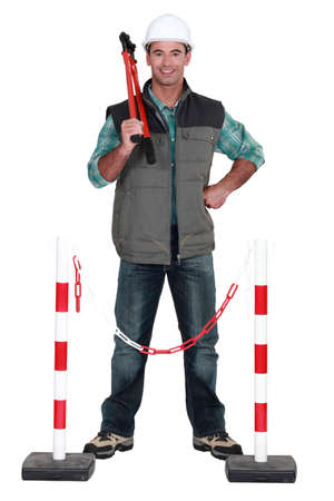 the unskilled worker: Tradesman standing in front of a barrier