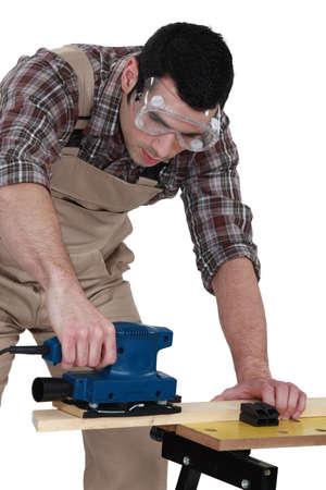 carpenter's sawdust: joiner using sander