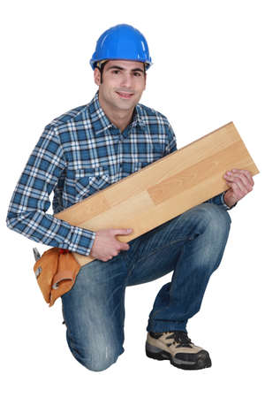 Builder with wooden flooring Stock Photo - 17220232