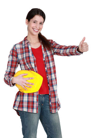 A female construction worker with the thumb up  photo