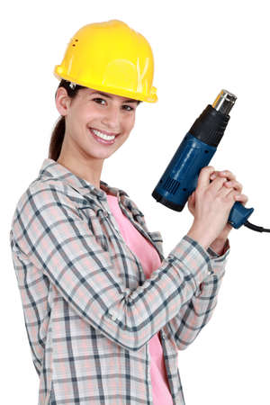 Woman holding electric heater Stock Photo - 17220477