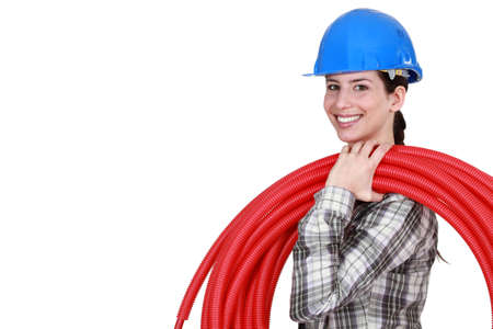 biased: female plumber carrying hose