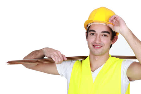 non verbal: Construction worker carrying plywood