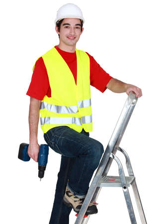 Man standing on ladder with drill Stock Photo - 17219890