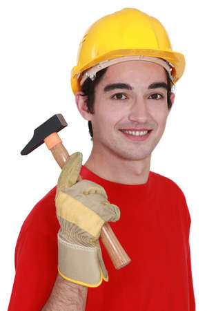Young builder with a hammer Stock Photo - 17219945