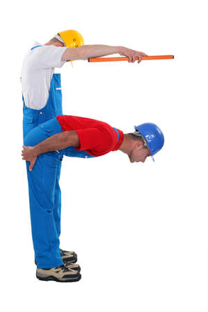 Two carpenters forming the letter F photo