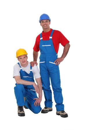 calzado de seguridad: Un equipo de artesanos posando para la cámara Foto de archivo
