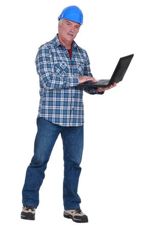 Experienced tradesman embracing technology Stock Photo - 17219780