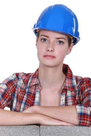 long faced: portrait of female bricklayer Stock Photo