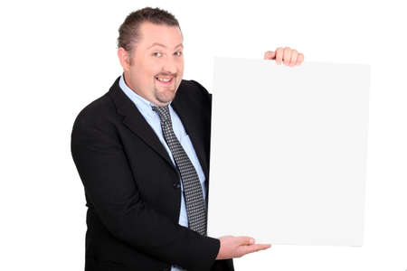 Businessman with a board left blank for your message photo