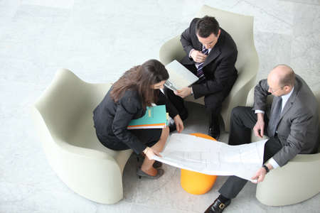Businesspeople having a meeting, top view photo