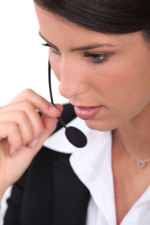 dark haired: close-up of a woman with headset Stock Photo