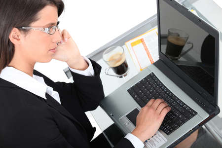 Top view of a woman using a laptop Stock Photo - 17220167