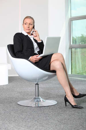 Businesswoman on the phone with laptop  photo
