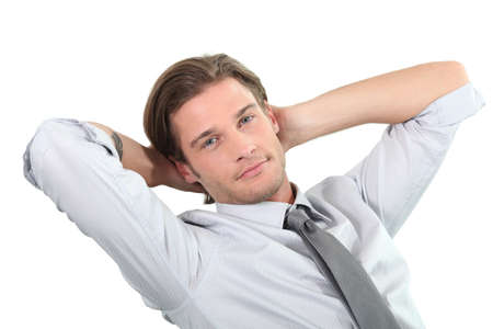 man front view: Young businessman sitting with arms behind head