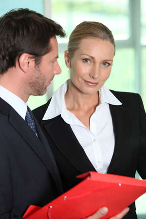 Businessman and woman smiling Stock Photo - 17220187