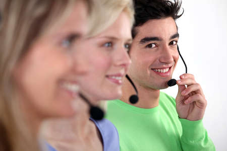 telephone headset: Young people working in a call centre Stock Photo