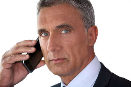 straight faced: Man talking on his mobile phone
