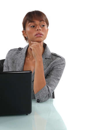 Businesswoman sitting at her desk with a laptop Stock Photo - 17220176