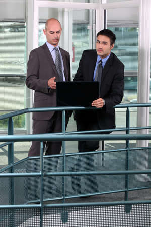 Businessmen, using laptop on hall Stock Photo - 17220511