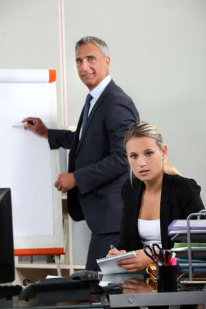 training room: Boss explaining theory to assistant