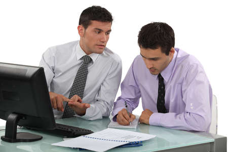Two businessmen working on project photo