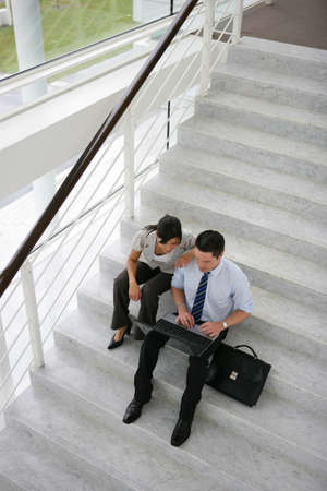 Business people on a stairwell photo