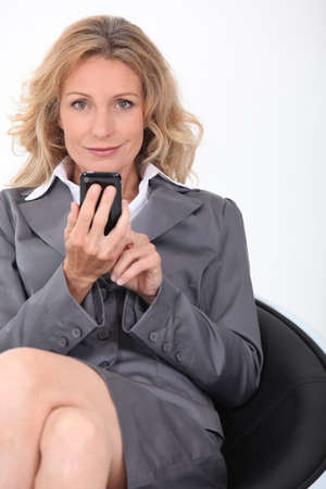 businesswoman in chair with phone photo