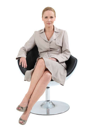 view of an elegant office: businesswoman on chair Stock Photo