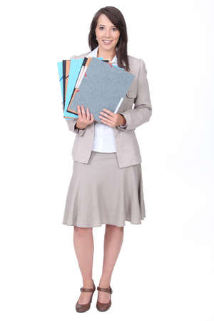 Twenty something dressed for the office with various folders Stock Photo - 17219847