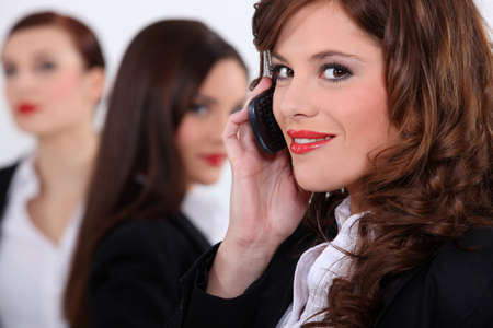 audacious: Attractive businesswomen with a cellphone