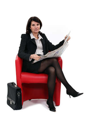 straight faced: Businesswoman reading Stock Photo