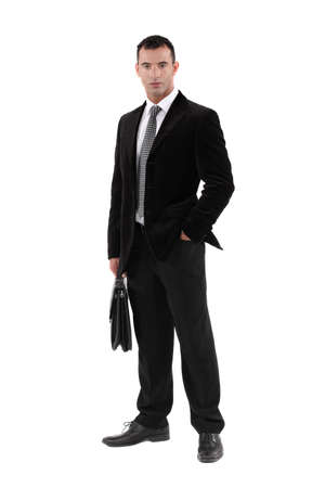 Businessman carrying briefcase Stock Photo - 17219501
