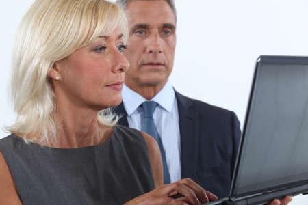 Middle-aged couple using laptop photo