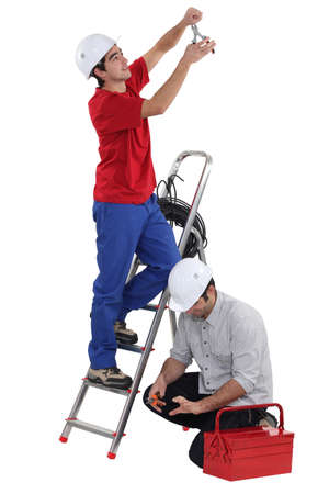 Two electricians working together photo