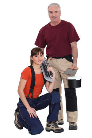 Tile cutter and female helper Stock Photo - 17219815