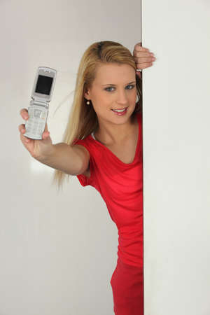 blonde woman showing a cell phone photo