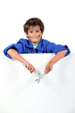 レンチを持つ少年 写真素材