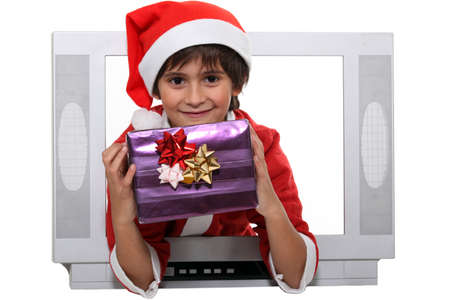 Little boy dressed as Santa escaping from television set Stock Photo - 17220004