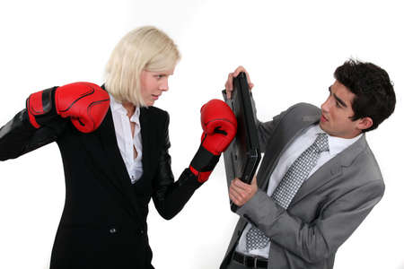 abuse young woman: Businesspeople boxing  Stock Photo