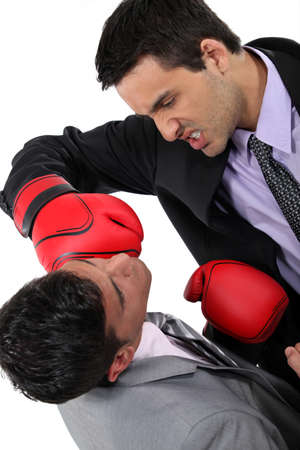 Two businessmen boxing photo