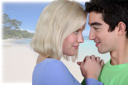 Young couple in front of tropical background photo